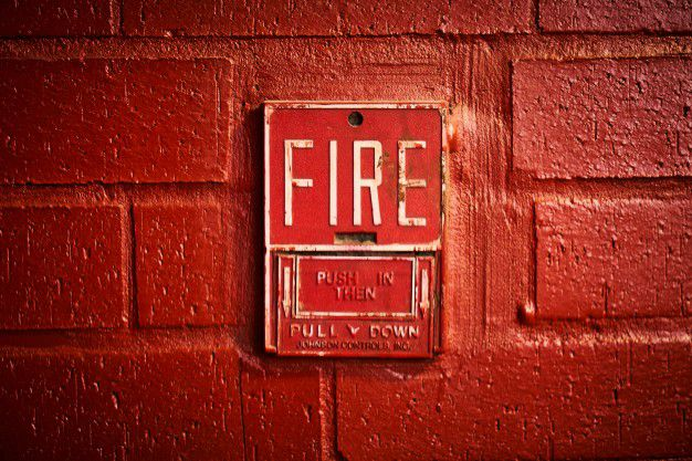 fire-alert-on-the-wall_1122-651